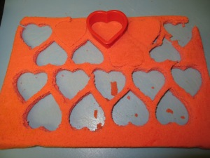 Cutting hearts out of the tray bake